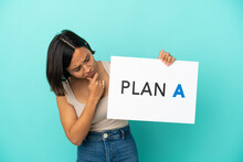 Young Mixed Race Woman Isolated On Blue Background Holding A Placard With The Message PLAN A And Thinking