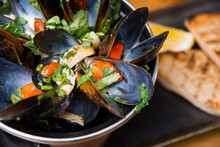 Close Up Photo Of Tasty Fresh Boiled Mussels In A Pan.