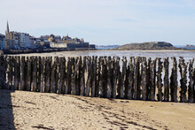 View Of The Beach, Wooden Wave Breaker And Town Of St Malo, France