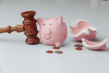 Broken Piggy Bank With Coins And Wooden Gavel. Business, Finance And Bankruptcy Concept.