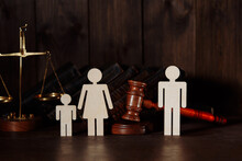 Family Figures With Judge Gavel. Divorce And Separation Concept.