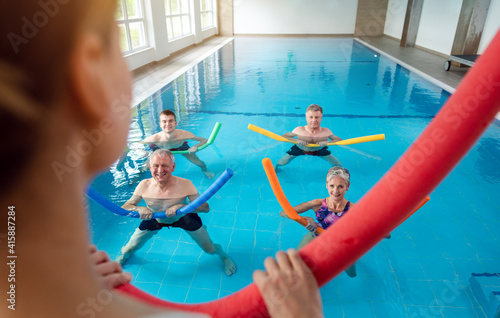 Fototapeta premium People in aqua fitness class during a physical therapy session