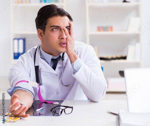 Fototapeta Doctor drug addict in the hospital obraz