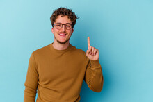 Young Caucasian Man Wearing Eyeglasses Isolated On Blue Background Showing Number One With Finger.