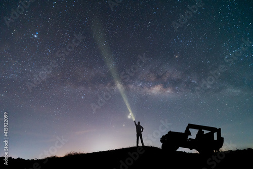 Tablou Canvas the car over the beautiful, wide blue night sky with stars and Milky way galaxy