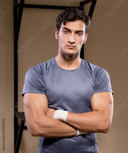 Fototapeta Ripped muscular man in gym doing sports obraz