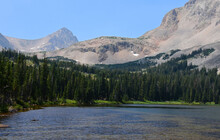 Magnificent Mount Toll And Mount Audobon As Seen From Mitchell Lake On A Sunny Summer Day Along The Blue Lake  Trail In The Indian Peaks Wilderness Area Near Nederland, Colorado