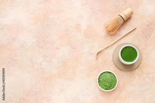 Fototapeta Composition with cup of matcha tea on color background obraz