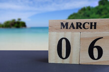 Day 6 Of March Month, Wooden Calendar With Date On Green Background. Empty Space For Text.