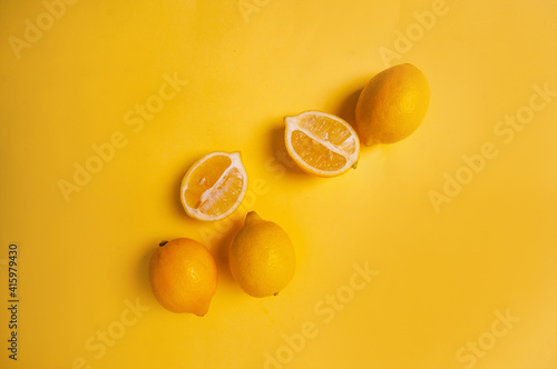 yellow-fruits-on-yellow-background-lemons-copy-space-pantone-2021-beautiful-juicy-colorful