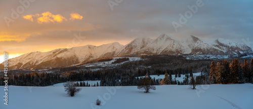 Beautiful mountain landscape during romantic winter sunrise - Tatra Mountains, Poland © Mike Mareen