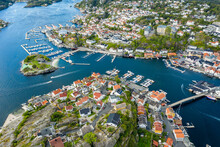 Aerial View Of Island Kragero, Traditional Village With Marinas At The Southern Norwegian Coast, Typical White Wooden Houses At The Waterfront, Norway
