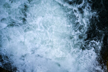 Beautiful Foamy Sea. Water Flowing From The Open Sluice Gates Of Dam. The Blue Sea Water With Spray