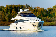 White Luxury Yacht In Motion On The Dniepr River, Side View.