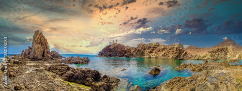 Panoramic view from the Arrecife de las Sirenas in Cabo de Gata, Spain. Sunset in Seascape with reefs and clouds