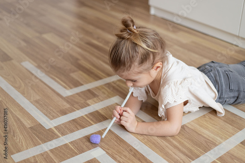 Child little girl playing homemade game with straw and pom pom for better articulation Tapéta, Fotótapéta