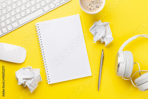 Fotografie, Obraz Office desk with supplies, headphones and blank notepad