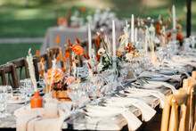 Luxury Wedding Reception, Dining Table Setup With Decoration On Rustic Wooden Table