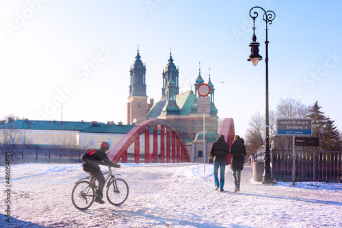 Poznan Cathedral and The Bishop Jordan Bridge over Warta River in the winter sun Poster Mural XXL