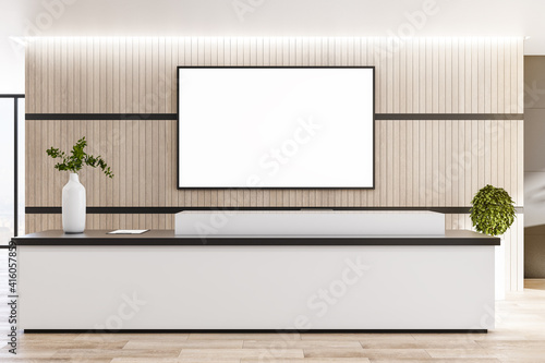 Foto Blank white screen in black frame on wooden wall behind reception area in modern eco style office