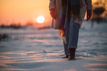 Anonymous Person Walking On Snowy Field