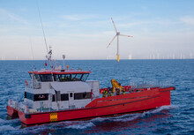 Crew Transfer Vessel About To Start Working In Wind Farm