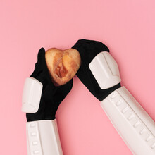 Storm Trooper Hands Are Offering Heart Covered In Raw Meat On Pink Background.
