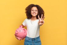 Pretty Afro Teenager Feeling Happy, Excited And Surprised, Looking To The Side With Both Hands On Face. Savings Concept