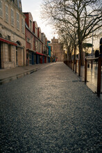Empty Street At Evening In La Rochelle, France. Saint Nicolas Tower In The Background