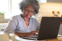 Thoughtful African American Senior Woman Using Laptop At Home
