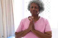 African American Senior Woman Practicing Yoga And Meditating At Home