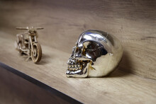 Silver Skull On Wooden Motorcycle Background