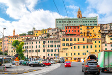 The Town Center Of Ventimiglia, Italy On The Italian Riviera, With The Colorful Hillside Homes And Cathedral Above.
