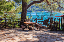 Empty Rustic Round Wooden Table And Stools In Park  In Kemer, Turkey