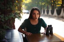 Jealous Woman With Binoculars Spying On Ex Boyfriend In Outdoor Cafe