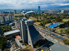 Beautiful Aerial View Of The City Of San Jose Costa Rica, Its Park Sabana, Buildings At Sunset