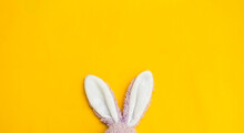 White Rabbit Ears On Yellow Fabric Background, Easter Concept Background
