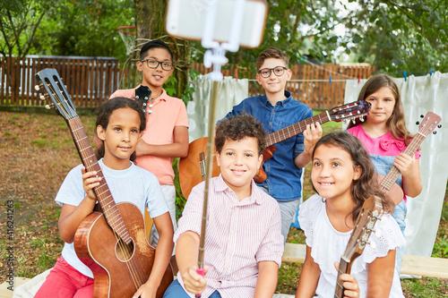 Fototapeta Children as a music band take selfie at summer camp obraz