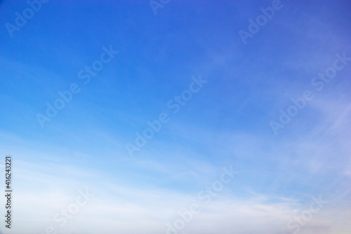 Fototapeta Blue sky background and white clouds soft focus, and copy space horizontal