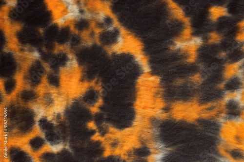 Papel de parede Black and orange camouflage abstract hand painted tie dye textu