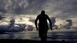 Young man enjoying sunset on exotic beach, super slow motion