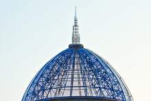Glass Dome On A Background Of Blue Sky. Top Of The Roof Close Up.