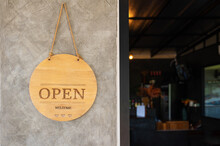Wooden Open Sign Board Hanging On Wall Brick Of Cafe