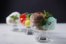 Set Of Ice Cream Scoops Of Different Colors And Flavors In Glass Sundae Bowls. Summer Delicious Food, Tasty Refreshing Dessert