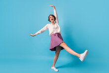 Full Length Photo Of Young Excited Girl Happy Positive Smile Have Fun Fooling Isolated Over Blue Color Background