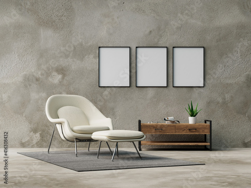 Three empty frames on wall from living room with armchair Fototapeta