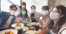 Friends Take Selfie In Restaurant