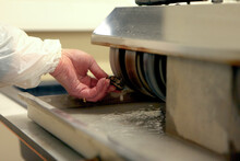 Laboratory Worker Polishing Boulder Precious Stone. Worker Hands, No Face, Unrecognizable Person. Worker Cutting A Stone