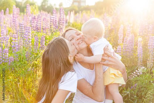 Fotografia, Obraz Young mother embracing her kids outdoor