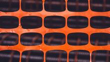 Orange Plastic Net On Construction Site. Texture Background Of Net. Orange Rectangle Pattern